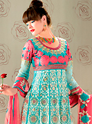 Try out this year top trend, glowing, bold and natural collection. The dazzling aqua blue georgette churidar suit have amazing embroidery patch work is done with resham, zari and stone work. The entire ensemble makes an excellent wear. Matching santoon churidar and pink chiffon dupatta is available with this suit. Slight Color variations are possible due to differing screen and photograph resolutions.