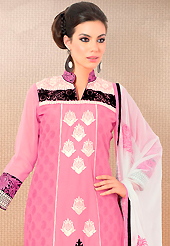 Outfit is a novel ways of getting yourself noticed. This pink cotton churidar suit have amazing embroidery patch work is done with resham work. Embroidery on kameez is highlighting the beauty of this suit. Contrasting white churidar and white chiffon dupatta come along with this suit. Slight Color variations are possible due to differing screen and photograph resolutions.