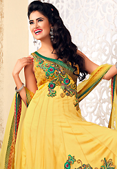 Take the fashion industry by storm in this beautiful embroidered suit. The dazzling yellow net readymade anarkali churidar suit have amazing embroidery patch work is done with resham, zari, stone, cutdana and beads work. Beautiful embroidery work on kameez is stunning. The entire ensemble makes an excellent wear. Matching churidar and dupatta is available with this suit. Slight Color variations are possible due to differing screen and photograph resolutions.