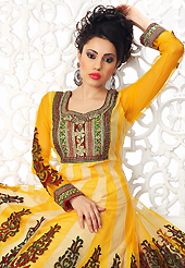 Ultimate collection of embroidered suits with fabulous style. The dazzling dark yellow and cream net readymade anarkali churidar suit have amazing embroidery patch work is done with resham, zari, stone, cutdana, beads and lace work. Beautiful embroidery work on kameez is stunning. The entire ensemble makes an excellent wear. Matching churidar and dupatta is available with this suit. Slight Color variations are possible due to differing screen and photograph resolutions.