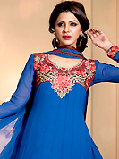 Get ready to sizzle all around you by sparkling suit. The dazzling blue chiffon churidar suit have amazing embroidery patch work is done with resham, zari and stone work. Beautiful embroidery work on kameez is stunning. The entire ensemble makes an excellent wear. Matching santoon churidar and chiffon dupatta is available with this suit. Slight Color variations are possible due to differing screen and photograph resolutions.