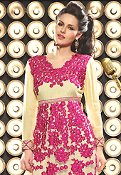 The glamorous silhouette to meet your most dire fashion needs. The dazzling light fawn net and viscose georgette churidar suit have amazing embroidery patch work is done with resham, zari and sequins work. Beautiful embroidery work on kameez is stunning. The entire ensemble makes an excellent wear. Contrasting pink santoon churidar and light fawn dupatta is available with this suit. Slight Color variations are possible due to differing screen and photograph resolutions.