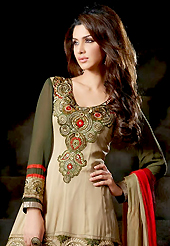 The fascinating beautiful subtly garment with lovely patterns. The dazzling fawn and dark olive green viscose georgette churidar suit have amazing embroidery patch work is done with resham and sequins work. Beautiful embroidery work on kameez is stunning. The entire ensemble makes an excellent wear. Contrasting red churidar and double dye dupatta is available with this suit. Slight Color variations are possible due to differing screen and photograph resolutions.