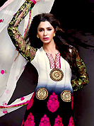 Outfit is a novel ways of getting yourself noticed. The dazzling shaded off white and black georgette churidar suit have amazing embroidery patch work is done with resham, zari and stone work. Beautiful embroidery work on kameez is stunning. Matching black santoon churidar and off white chiffon dupatta is available with this suit. Slight Color variations are possible due to differing screen and photograph resolutions.