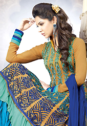 The glamorous silhouette to meet your most dire fashion needs. The dazzling fawn and blue faux georgette churidar suit have amazing embroidery patch work is done with resham, sequins and lace work. Beautiful embroidery work on kameez is stunning. The entire ensemble makes an excellent wear. Matching santoon churidar and blue chiffon dupatta is available with this suit. Slight Color variations are possible due to differing screen and photograph resolutions.