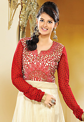Get ready to sizzle all around you by sparkling suit. The dazzling cream and red net and cotton readymade churidar suit have amazing embroidery patch work is done with resham, zari and beads work. The entire ensemble makes an excellent wear. Matching red churidar and red dupatta is available with this suit. Slight Color variations are possible due to differing screen and photograph resolutions.