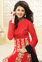 Dreamy variation on shape and forms compliment your style with tradition. The dazzling salsa red faux georgette readymade churidar suit have amazing embroidery patch work is done with zari work. The entire ensemble makes an excellent wear. Matching churidar and black dupatta is available with this suit. Slight Color variations are possible due to differing screen and photograph resolutions.