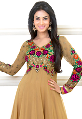 Take a look on the changing fashion of the season. The dazzling fawn faux georgette anarkali churidar suit have amazing embroidery patch work is done with resham, zari, sequins, stone and lace work. Beautiful embroidery work on kameez is stunning. The entire ensemble makes an excellent wear. Matching santoon churidar and faux chiffon dupatta is available with this suit. Slight Color variations are possible due to differing screen and photograph resolutions.