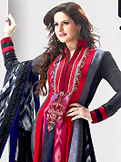 Breathtaking collection of suits with stylish embroidery work and fabulous style. The dazzling dark grey and red satin anarkali churidar suit have amazing embroidery patch work is done with resham and sequins work. Beautiful embroidery work on kameez is stunning. The entire ensemble makes an excellent wear. Contrasting black santoon churidar and shaded grey dupatta is available with this suit. Slight Color variations are possible due to differing screen and photograph resolutions.