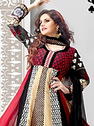 An occasion wear perfect is ready to rock you. The dazzling sand brown, black and red cotton and satin anarkali churidar suit have amazing embroidery patch work is done with resham, zari, sequins and lace work. Beautiful embroidery work on kameez is stunning. The entire ensemble makes an excellent wear. Matching black santoon churidar and dupatta is available with this suit. Slight Color variations are possible due to differing screen and photograph resolutions.