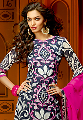 Attract all attentions with this embroidered suit. The dazzling dark navy blue and off white faux crepe churidar suit have amazing embroidery patch work is done with resham, zari and stone work. The entire ensemble makes an excellent wear. Contrasting black churidar and pink dupatta is available with this suit. Slight Color variations are possible due to differing screen and photograph resolutions.