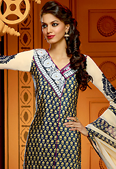 Your search for elegant look ends here with this lovely suit. The dazzling dark navy blue and buttercream faux crepe churidar suit have amazing embroidery patch work is done with resham, zari, stone and mirror work. The entire ensemble makes an excellent wear. Matching dark navy blue churidar and buttercream dupatta is available with this suit. Slight Color variations are possible due to differing screen and photograph resolutions.