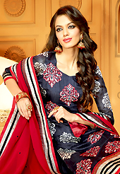 The glamorous silhouette to meet your most dire fashion needs. The dazzling dark navy blue faux crepe churidar suit have amazing embroidery patch work is done with resham, zari and stone work. The entire ensemble makes an excellent wear. Matching churidar and red dupatta is available with this suit. Slight Color variations are possible due to differing screen and photograph resolutions.