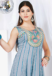 Take the fashion industry by storm in this beautiful embroidered suit. The dazzling grey faux georgette readymade churidar suit have amazing embroidery and silk patch bordered work is done with resham, sequins, stone, cutdana, gota patti and kasab work. Beautiful embroidery work on kameez is stunning. The entire ensemble makes an excellent wear. Contrasting teal blue santoon churidar and double dye dupatta is available with this suit. Slight Color variations are possible due to differing screen and photograph resolutions.
