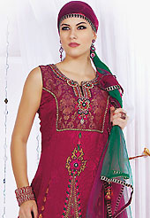 Embroidered suits are the best choice for a girl to enhance her feminine look. The dazzling dark magenta jacquard readymade churidar suit have amazing embroidery patch work is done with resham, stone, cutdana, cut moti, kasab and lace work. Beautiful embroidery work on kameez is stunning. The entire ensemble makes an excellent wear. Matching santoon churidar and shaded net dupatta is available with this suit. Slight Color variations are possible due to differing screen and photograph resolutions.