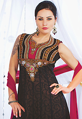 Ultimate collection of embroidered suits with fabulous style. The dazzling black net readymade churidar suit have amazing embroidery patch work is done with stone, cutdana, kasab, kundan, pull moti and lace work. Beautiful embroidery work on kameez is stunning. The entire ensemble makes an excellent wear. Contrasting red santoon churidar and red net dupatta is available with this suit. Slight Color variations are possible due to differing screen and photograph resolutions.