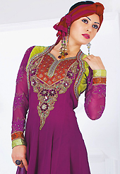 Dreamy variation on shape and forms compliment your style with tradition. The dazzling magenta faux georgette readymade churidar suit have amazing embroidery and velvet patch work is done with resham, stone, cutdana, cut moti, kundan and lace work. Beautiful embroidery work on kameez is stunning. The entire ensemble makes an excellent wear. Matching santoon churidar and shaded net dupatta is available with this suit. Slight Color variations are possible due to differing screen and photograph resolutions.