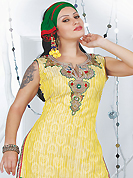 Attract all attentions with this embroidered suit. The dazzling yellow art silk readymade salwar kameez have amazing embroidery patch work is done with resham, sequins, stone, cutdana and kasab work. Beautiful embroidery work on kameez is stunning. The entire ensemble makes an excellent wear. Contrasting red salwar and green dupatta is available with this suit. Slight Color variations are possible due to differing screen and photograph resolutions.