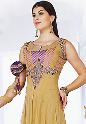 Outfit is a novel ways of getting yourself noticed. The dazzling fawn and purple net readymade churidar suit have amazing embroidery and brocade patch bordered work is done with resham, sequins, stone, kasab and lace work. Beautiful embroidery work on kameez is stunning. The entire ensemble makes an excellent wear. Matching purple santoon churidar and double dye net dupatta is available with this suit. Slight Color variations are possible due to differing screen and photograph resolutions.