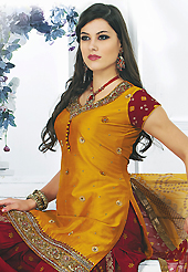 Take the fashion industry by storm in this beautiful embroidered suit. The dazzling mustard chanderi silk readymade salwar kameez have amazing bandhej print and embroidery patch work is done with resham, sequins, stone, cutdana and kasab work. Beautiful embroidery work on kameez is stunning. The entire ensemble makes an excellent wear. Contrasting dark red santoon salwar and mustard faux chiffon dupatta is available with this suit. Slight Color variations are possible due to differing screen and photograph resolutions.