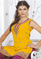 Style and trend will be at the peak of your beauty when you adorn this suit. The dazzling yellow faux georgette readymade salwar kameez have amazing embroidery patch work is done with resham, sequins, stone, cutdana and kasab work. Beautiful embroidery work on kameez is stunning. The entire ensemble makes an excellent wear. Contrasting dark magenta banarasi viscose salwar and dark magenta faux chiffon dupatta is available with this suit. Slight Color variations are possible due to differing screen and photograph resolutions.