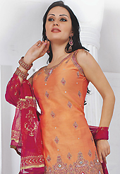The glamorous silhouette to meet your most dire fashion needs. The dazzling peach chanderi silk readymade salwar kameez have amazing embroidery patch work is done with resham, stone, kasab and moti work. Beautiful embroidery work on kameez is stunning. The entire ensemble makes an excellent wear. Contrasting red faux georgette salwar and red faux chiffon dupatta is available with this suit. Slight Color variations are possible due to differing screen and photograph resolutions.