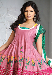 It is color this season and bright shaded suits are really something that is totally in vogue. The dazzling pink and dark blue cotton silk readymade anarkali churidar suit have amazing floral print and embroidery patch work is done with resham work. Beautiful embroidery work on kameez is stunning. The entire ensemble makes an excellent wear. Contrasting dark green churidar and double dye crush dupatta is available with this suit. Slight Color variations are possible due to differing screen and photograph resolutions.