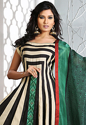 The most beautiful refinements for style and tradition. The dazzling beige and black cotton silk readymade anarkali churidar suit have amazing embroidery patch work is done with resham work. Beautiful embroidery work on kameez is stunning. The entire ensemble makes an excellent wear. Matching black churidar and green dupatta is available with this suit. Slight Color variations are possible due to differing screen and photograph resolutions.