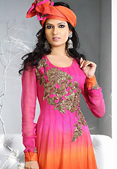 Breathtaking collection of suits with stylish embroidery work and fabulous style. The dazzling shaded pink and orange georgette readymade anarkali churidar suit have amazing embroidery patch work is done with zari, sequins, stone and lace work. Beautiful embroidery work on kameez is stunning. The entire ensemble makes an excellent wear. Matching dark pink santoon churidar and orange dupatta is available with this suit. Slight Color variations are possible due to differing screen and photograph resolutions.