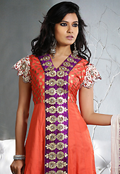 Breathtaking collection of suits with stylish embroidery work and fabulous style. The dazzling dark orange cotton readymade churidar suit have amazing embroidery patch work is done with zari, applique and sequins work. Beautiful embroidery work on kameez is stunning. The entire ensemble makes an excellent wear. Contrasting dark purple churidar and off white dupatta is available with this suit. Slight Color variations are possible due to differing screen and photograph resolutions.