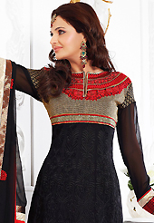 The glamorous silhouette to meet your most dire fashion needs. The dazzling black faux georgette anarkali churidar suit have amazing embroidery patch work is done with resham, zari and lace work. Beautiful embroidery work on kameez is stunning. The entire ensemble makes an excellent wear. Matching santoon churidar and faux chiffon dupatta is available with this suit. Slight Color variations are possible due to differing screen and photograph resolutions.