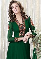 It is color this season and bright shaded suits are really something that is totally in vogue. The dazzling dark green faux georgette churidar suit have amazing embroidery patch work is done with resham and zari work. Beautiful embroidery work on kameez is stunning. The entire ensemble makes an excellent wear. Contrasting red santoon churidar and double dye chiffon dupatta is available with this suit. Slight Color variations are possible due to differing screen and photograph resolutions.