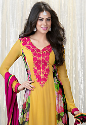 The fascinating beautiful subtly garment with lovely patterns. The dazzling yellow faux georgette churidar suit have amazing floral print and embroidery patch work is done with resham and lace work. Beautiful embroidery work on kameez is stunning. The entire ensemble makes an excellent wear. Contrasting dark pink santoon churidar and dark pink chiffon dupatta is available with this suit. Slight Color variations are possible due to differing screen and photograph resolutions.