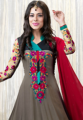 Take a look on the changing fashion of the season. The dazzling dusty grey faux georgette churidar suit have amazing embroidery patch work is done with resham work. Beautiful embroidery work on kameez is stunning. The entire ensemble makes an excellent wear. Contrasting red santoon churidar and red chiffon dupatta is available with this suit. Slight Color variations are possible due to differing screen and photograph resolutions.