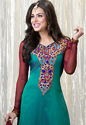 Get ready to sizzle all around you by sparkling suit. The dazzling teal green faux georgette churidar suit have amazing embroidery patch work is done with resham, zari and stone work. Beautiful embroidery work on kameez is stunning. The entire ensemble makes an excellent wear. Contrasting maroon santoon churidar and maroon chiffon dupatta is available with this suit. Slight Color variations are possible due to differing screen and photograph resolutions.