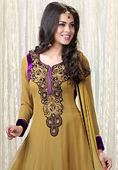 An occasion wear perfect is ready to rock you. The dazzling mustard faux georgette churidar suit have amazing embroidery patch work is done with resham, sequins and stone work. Beautiful embroidery work on kameez is stunning. The entire ensemble makes an excellent wear. Matching santoon churidar and double dye chiffon dupatta is available with this suit. Slight Color variations are possible due to differing screen and photograph resolutions.
