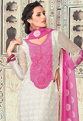 Attract all attentions with this embroidered suit. The dazzling white georgette churidar suit have amazing embroidery patch work is done with resham and lace work. The entire ensemble makes an excellent wear. Matching santoon churidar and pink chiffon dupatta is available with this suit. Slight Color variations are possible due to differing screen and photograph resolutions.