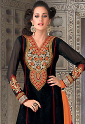 The most beautiful refinements for style and tradition. The dazzling black jacquard churidar suit have amazing embroidery patch work is done with resham and lace work. The entire ensemble makes an excellent wear. Contrasting orange santoon churidar and orange and red chiffon dupatta is available with this suit. Slight Color variations are possible due to differing screen and photograph resolutions.