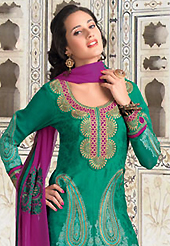 Dreamy variation on shape and forms compliment your style with tradition. The dazzling green jacquard churidar suit have amazing embroidery patch work is done with resham work. The entire ensemble makes an excellent wear. Matching santoon churidar and magenta chiffon dupatta is available with this suit. Slight Color variations are possible due to differing screen and photograph resolutions.