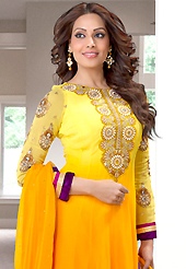 This season dazzle and shine in pure colors. The dazzling shaded yellow georgette anarkali churidar suit have amazing embroidery patch work is done with resham, zari, sequins, stone and lace work. Beautiful embroidery work on kameez is stunning. The entire ensemble makes an excellent wear. Matching santoon churidar and chiffon dupatta is available with this suit. Slight Color variations are possible due to differing screen and photograph resolutions.