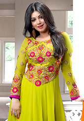 The color range from natural shades looks ravishing. The dazzling pastel green georgette anarkali churidar suit have amazing embroidery patch work is done with resham, zari, stone and lace work. Beautiful embroidery work on kameez is stunning. The entire ensemble makes an excellent wear. Matching santoon churidar and shaded chiffon dupatta is available with this suit. Slight Color variations are possible due to differing screen and photograph resolutions.