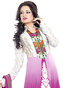 Look stunning rich with dark shades and floral patterns. The dazzling white and shaded magenta georgette anarkali churidar suit have amazing embroidery patch work is done with resham and zari work. Beautiful embroidery work on kameez is stunning. The entire ensemble makes an excellent wear. Matching magenta santoon churidar and magenta chiffon dupatta is available with this suit. Slight Color variations are possible due to differing screen and photograph resolutions.