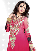 Take a look on the changing fashion of the season. The dazzling shaded dark pink georgette anarkali churidar suit have amazing embroidery patch work is done with resham and zari work. Beautiful embroidery work on kameez is stunning. The entire ensemble makes an excellent wear. Matching santoon churidar and chiffon dupatta is available with this suit. Slight Color variations are possible due to differing screen and photograph resolutions.