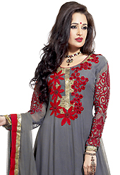 Your search for elegant look ends here with this lovely suit. The dazzling grey georgette anarkali churidar suit have amazing embroidery patch work is done with resham and zari work. Beautiful embroidery work on kameez is stunning. The entire ensemble makes an excellent wear. Matching santoon churidar and chiffon dupatta is available with this suit. Slight Color variations are possible due to differing screen and photograph resolutions.