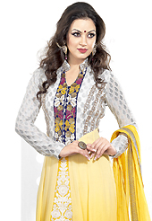 Attract all attentions with this embroidered suit. The dazzling yellow and white georgette anarkali churidar suit have amazing embroidery patch work is done with resham and zari work. Beautiful embroidery work on kameez is stunning. The entire ensemble makes an excellent wear. Matching yellow santoon churidar and yellow chiffon dupatta is available with this suit. Slight Color variations are possible due to differing screen and photograph resolutions.