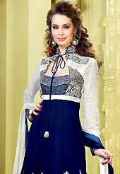 A desire that evokes a sense of belonging with a striking details. The dazzling navy blue faux georgette churidar suit have amazing embroidery patch work is done with resham, zari, sequins and stone work. Beautiful embroidery work on kameez is stunning. The entire ensemble makes an excellent wear. Matching santoon churidar and double dye dupatta is available with this suit. Slight Color variations are possible due to differing screen and photograph resolutions.
