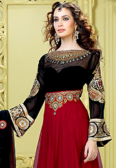 Your search for elegant look ends here with this lovely suit. The dazzling maroon and black net churidar suit have amazing embroidery patch work is done with resham, zari, sequins, stone and beads work. Beautiful embroidery work on kameez is stunning. The entire ensemble makes an excellent wear. Matching black santoon churidar and black net dupatta is available with this suit. Slight Color variations are possible due to differing screen and photograph resolutions.
