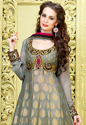 Attract all attentions with this embroidered suit. The dazzling light grey viscose georgette long pakistani style churidar suit have amazing embroidery patch work is done with resham, zari, sequins, stone and lace work. Beautiful embroidery work on kameez is stunning. The entire ensemble makes an excellent wear. Matching santoon churidar and faux chiffon dupatta is available with this suit. Slight Color variations are possible due to differing screen and photograph resolutions.