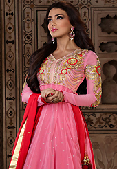 It is color this season and bright shaded suits are really something that is totally in vogue. The dazzling pink net long style anarkali churidar suit have amazing embroidery patch work is done with resham, zari, sequins, stone and latken work. Beautiful embroidery work on kameez is stunning. The entire ensemble makes an excellent wear. Matching dark pink santoon churidar and dark pink chiffon dupatta is available with this suit. Slight Color variations are possible due to differing screen and photograph resolutions.