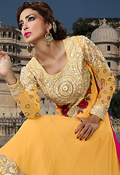 A desire that evokes a sense of belonging with a striking details. The dazzling dark yellow georgette long style anarkali churidar suit have amazing embroidery patch work is done with resham, sequins, stone and lace work. Beautiful embroidery work on kameez is stunning. The entire ensemble makes an excellent wear. Matching santoon churidar and pink chiffon dupatta is available with this suit. Slight Color variations are possible due to differing screen and photograph resolutions.